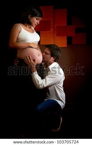 Happy pregnant couple - stock photo