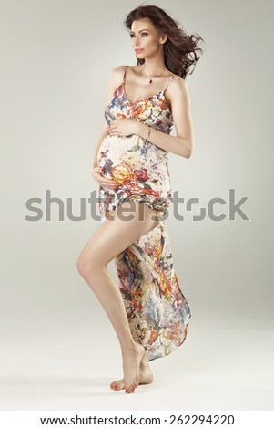 Happy pregnant woman - stock photo