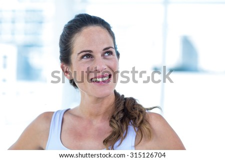 Happy pregnant woman looking up at home
