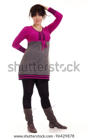 Happy pregnant woman standing on white background