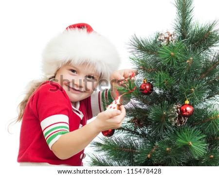 happy preschool girl decorating Christmas tree isolated on white - stock photo