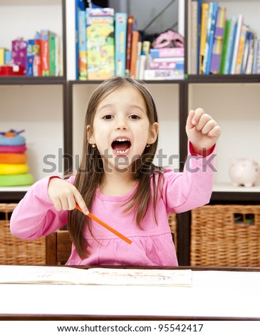 happy preschool girl in her room ready for back to school - stock photo