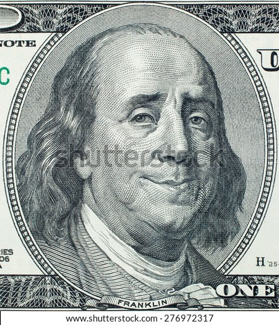 Happy President Benjamin Franklin portrait on 100 US dollar bill