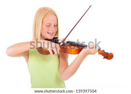 happy preteen girl playing violin against white background - stock photo