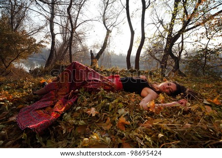 Happy pretty girl in forest at sunset .Art photo - stock photo