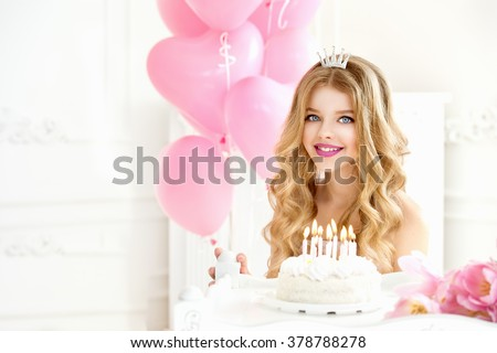 Happy pretty girl with cream cake at birthday party. Happy girl with pink balloons smiling and laughing. Barbie style. Princess. Barbie girl.Smiling Girl with tiara crown
