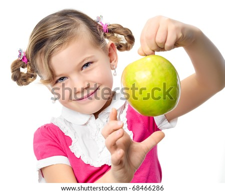 happy pretty girl with green apple on white background - stock photo
