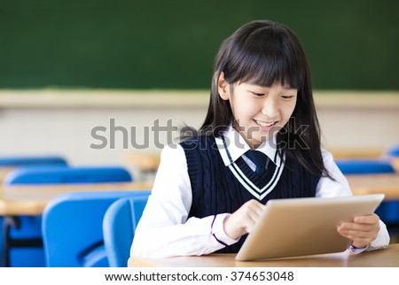 happy pretty  student girl with tablet  in classroom - stock photo