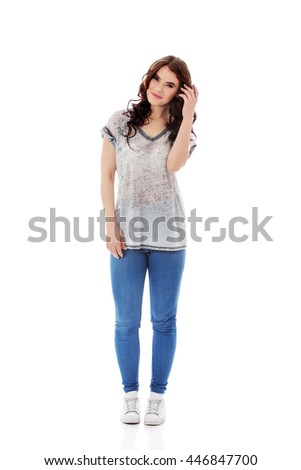 Happy pretty young brunette woman  - stock photo
