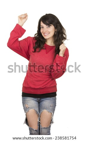happy pretty young girl wearing red top posing with fists up gesturing yes isolated on white