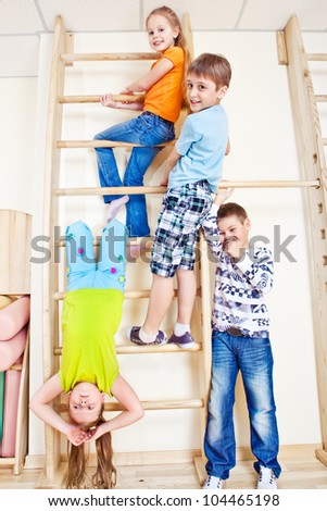 Happy primary school students in gym - stock photo
