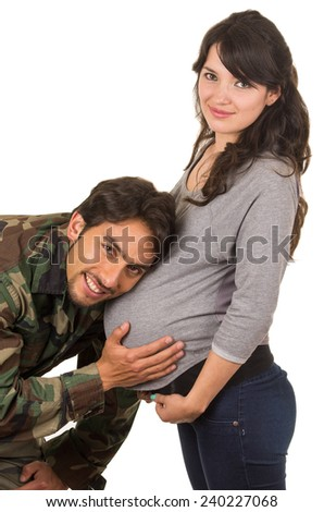 happy proud military soldier hugging pregnant wife listening to belly isolated on white - stock photo