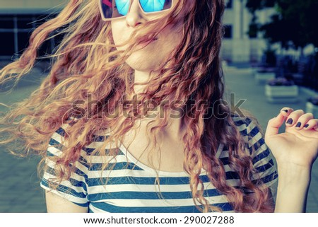 Happy redhead women shaking her head. Summertime fun and happyness - stock photo