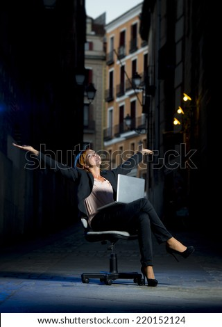 Happy relaxed Business woman office dressed sitting on Chair outdoors on Street with Computer laptop in successful and flexible worker concept on studio lighting  - stock photo