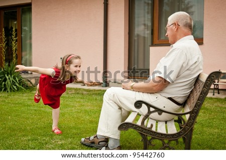 Happy retirement with grandchild - stock photo
