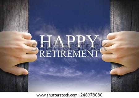 Happy Retirement word floating in the Sky behind a dark wooden door opening. - stock photo