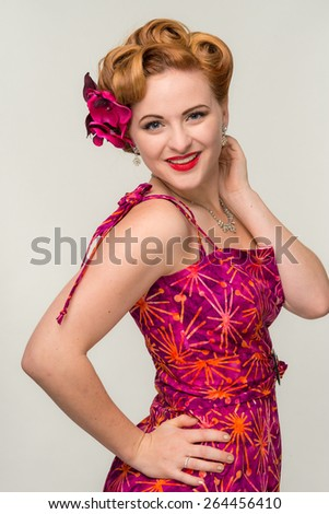 Happy retro styled woman in vintage dress