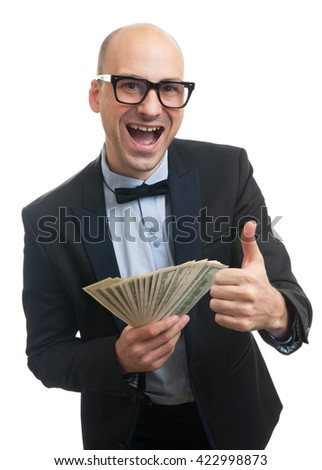 Happy rich man holding a lot of money and gesturing thumb up