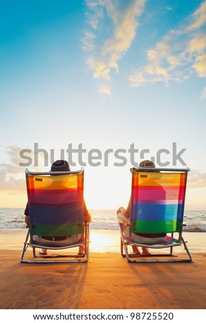 Happy Romantic Couple Enjoying Beautiful Sunset at the Beach - stock photo