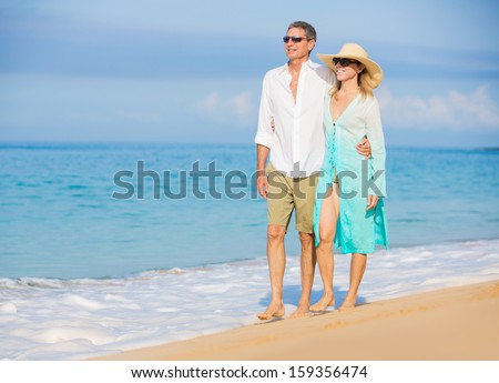 Happy Romantic Couple Walking on the Beach - stock photo