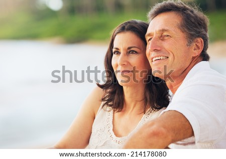 Happy Romantic Mature Couple Enjoying Sunset on the Beach - stock photo