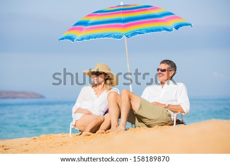 Happy Romantic Middle Age Couple Relaxing on Tropical Beach, Vacation Concept - stock photo