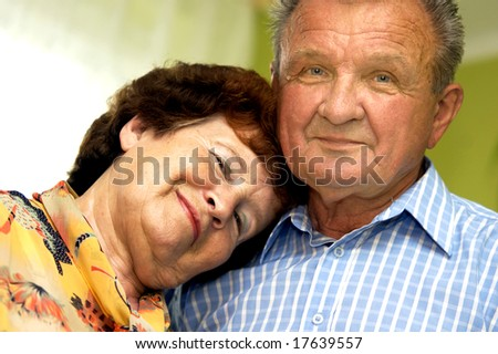 Happy romantic senior couple in home - stock photo