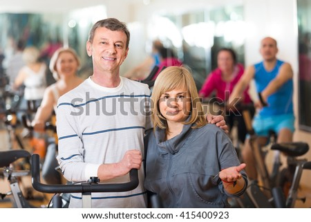 happy russian mature man and woman posing in a gym and smiling