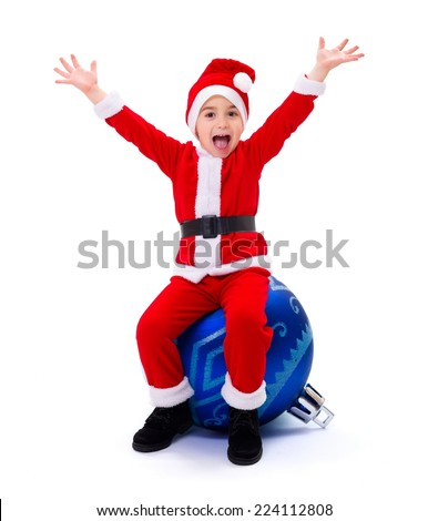 Happy Santa Claus boy sitting on blue Christmas on ornament - stock photo