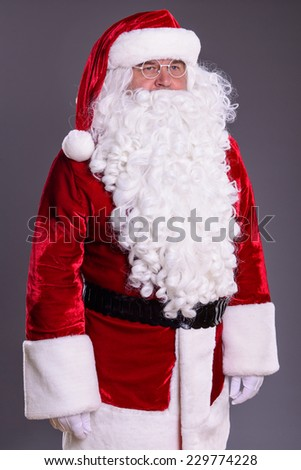 happy Santa Claus on gray background