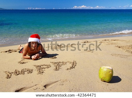 Happy santa Claus with coconut on beach