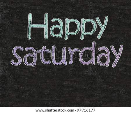 happy saturday written on blackboard blackboatd, working fun and happy business concept.