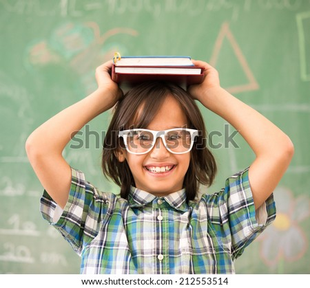 Happy school boy posing for education portrait - stock photo