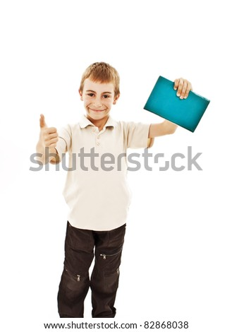 Happy school boy with thumbs up isolated on white - stock photo