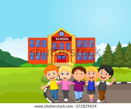 Happy school children in front of school - stock photo