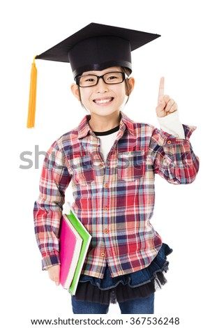 happy school kid in graduation cap with success gesture