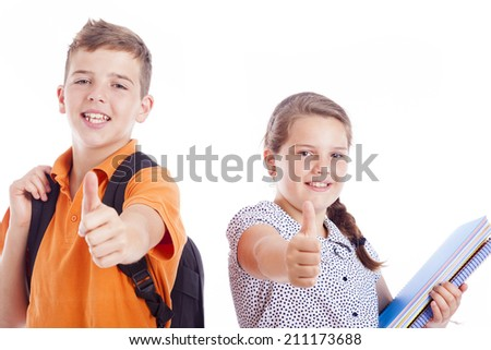 Happy school kids with thumbs up, isolated on white background - stock photo