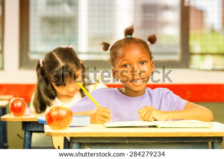 Happy school scene. Elementary class. - stock photo