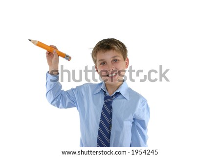 Happy schoolboy holding a pencil in a writing position