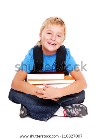 Happy schoolboy sitting on the floor