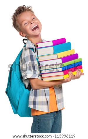Happy schoolboy with backpack and books isolated on white background