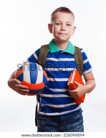 Happy schoolboy with backpack, ball and books isolated on white background - stock photo