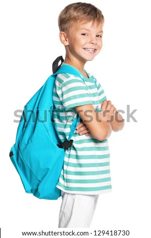 Happy schoolboy with backpack isolated on white background - stock photo