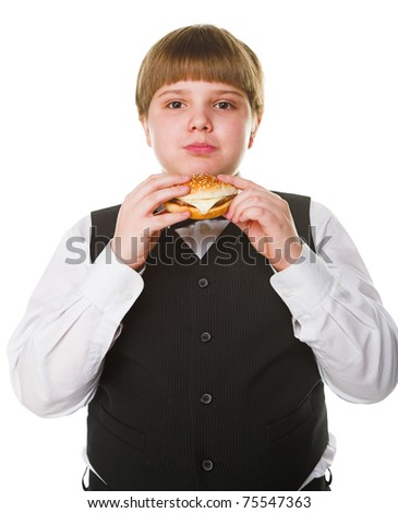 happy schoolboy with big burger isolated on white - stock photo