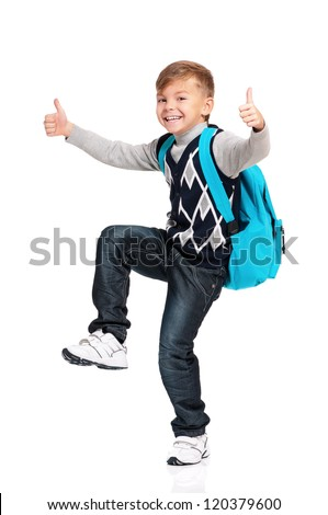 Happy schoolboy with thumbs up isolated on white background - stock photo