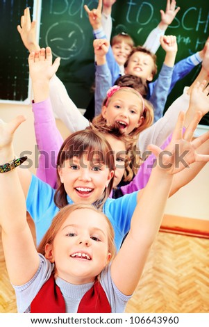 Happy schoolchildren at a classroom. Education. - stock photo