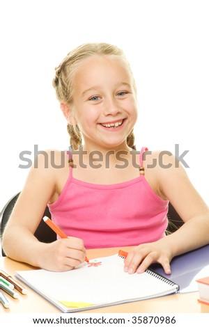 Happy schoolgirl drawing - stock photo