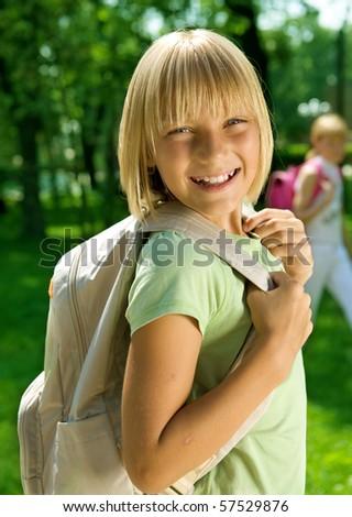 Happy Schoolgirl Outdoor.Back to School. - stock photo