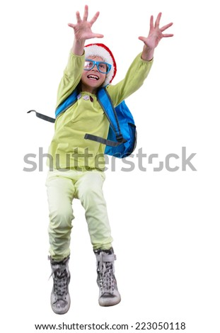 happy schoolgirl with Santa red hat with a backpack  exercising, running and jumping. Isolated over white background. Education childhood concept - stock photo