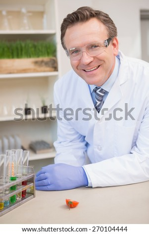 Happy scientist looking at camera in the laboratory